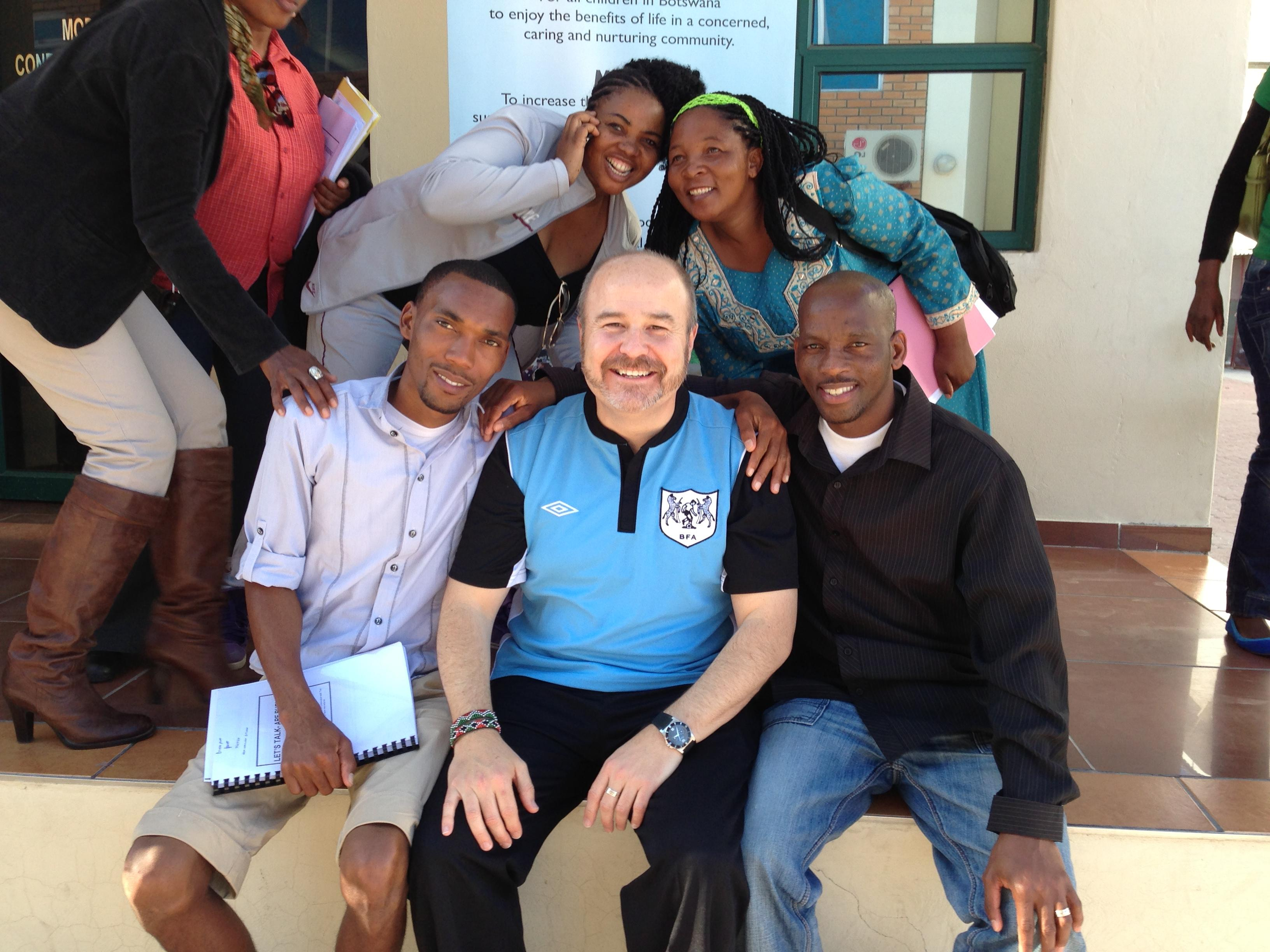Gary Harper in Maun, Botswana with participants in a national-level training workshop focused on building the capacity of child service providers to provide developmentally appropriate services to adolescents impacted by HIV.