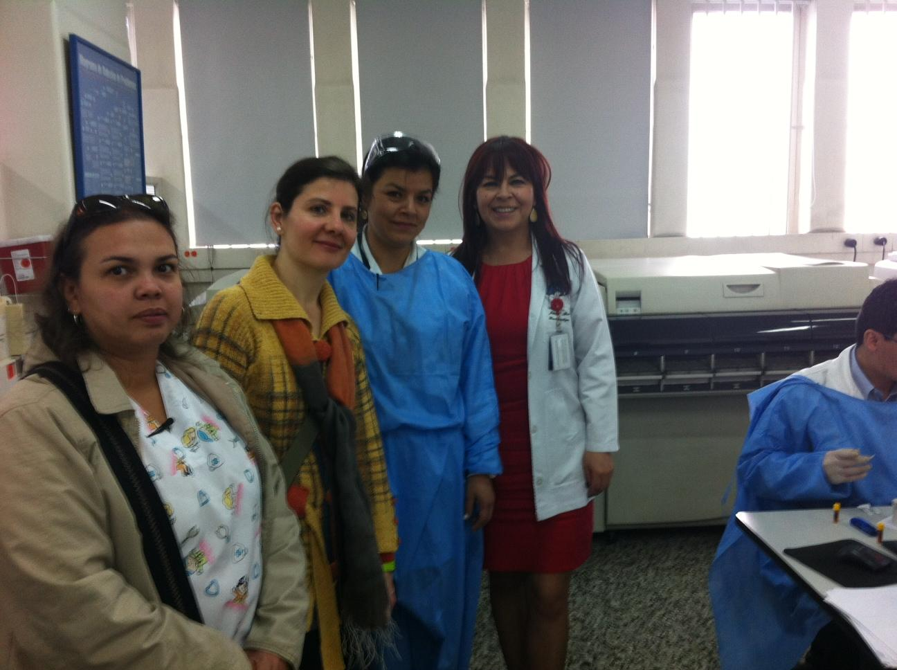 Ana Baylin meets with lab staff at San Rafael Hospital in Bogota, Colombia. The team collected and stored blood samples for a case crossover study on myocardial infarction that Baylin and her team did.