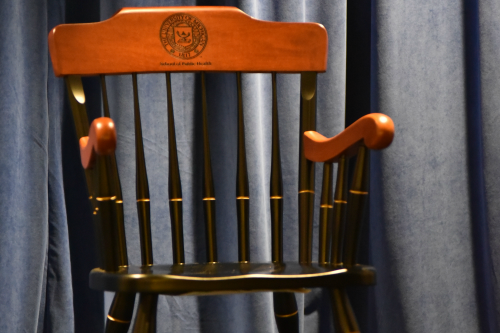 The second gift presented, is a maple hardwood engraved Michigan chair.