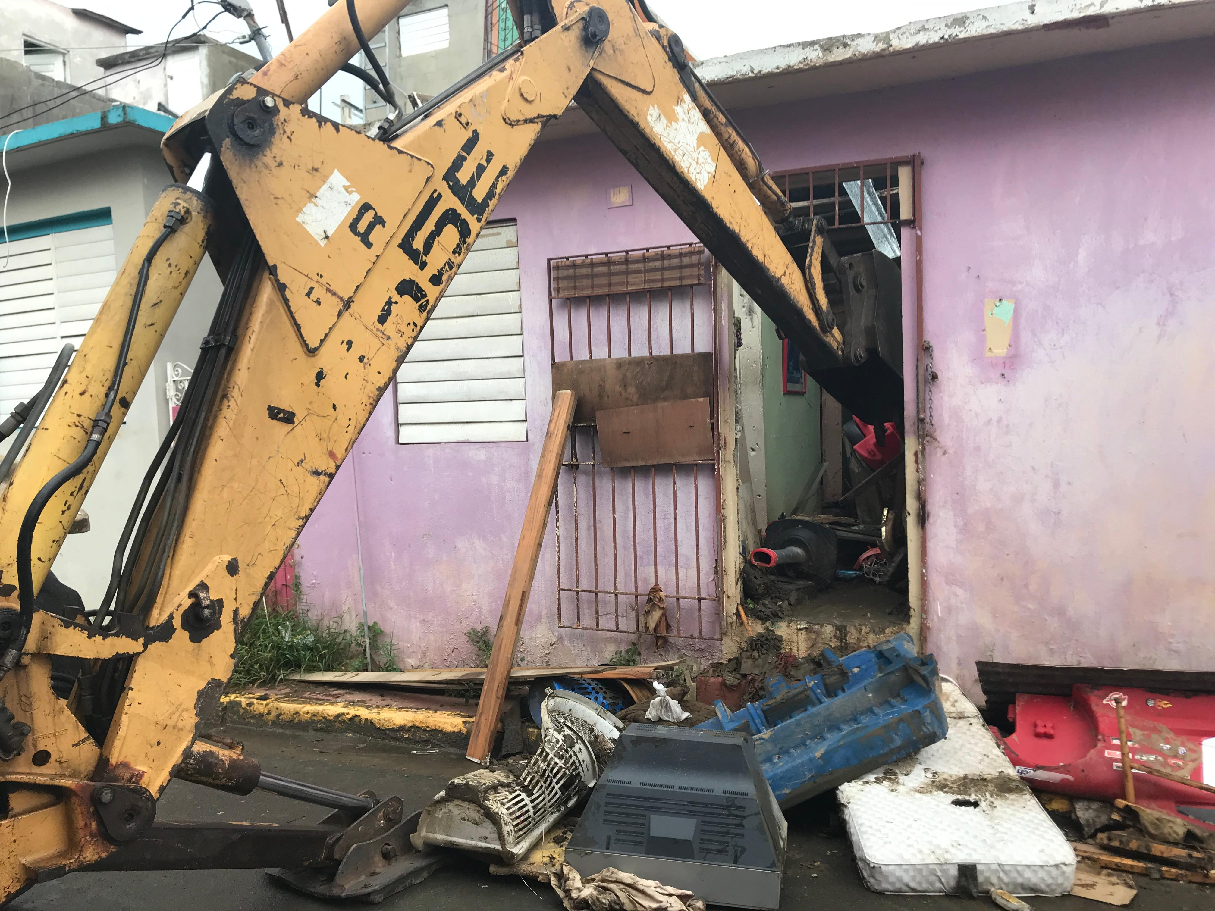 Amilcar Matos-Moreno's group rented a digger and dump truck to not only clean out the homes but also to support the Puerto Rican economy.
