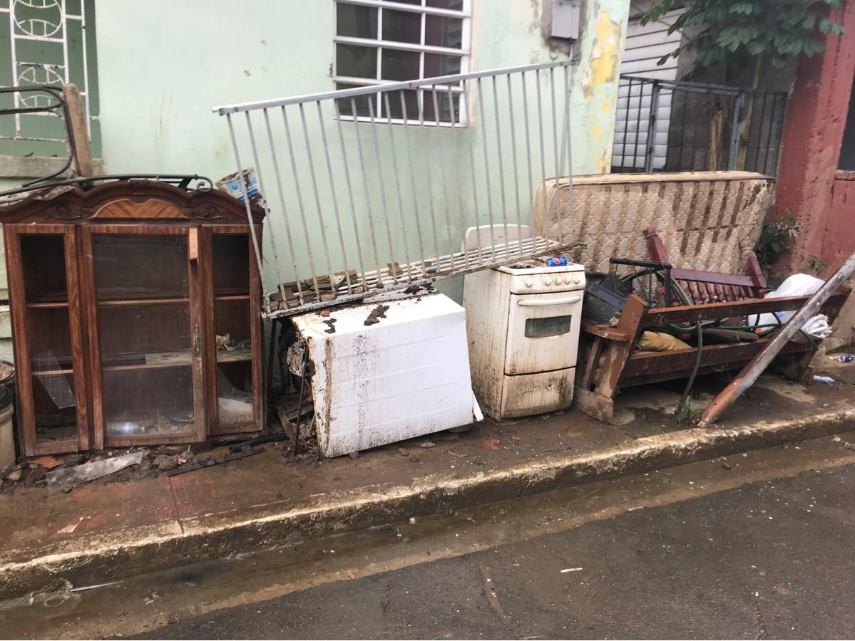 After a flood, there are a lot of appliances out on the street because they no longer function. Every single house had a fridge, microwave, and stove sitting outside. Matos-Moreno and the volunteers worked from 7 am to 5 pm picking up these appliances throughout the community and filled up a dump trunk seven times.