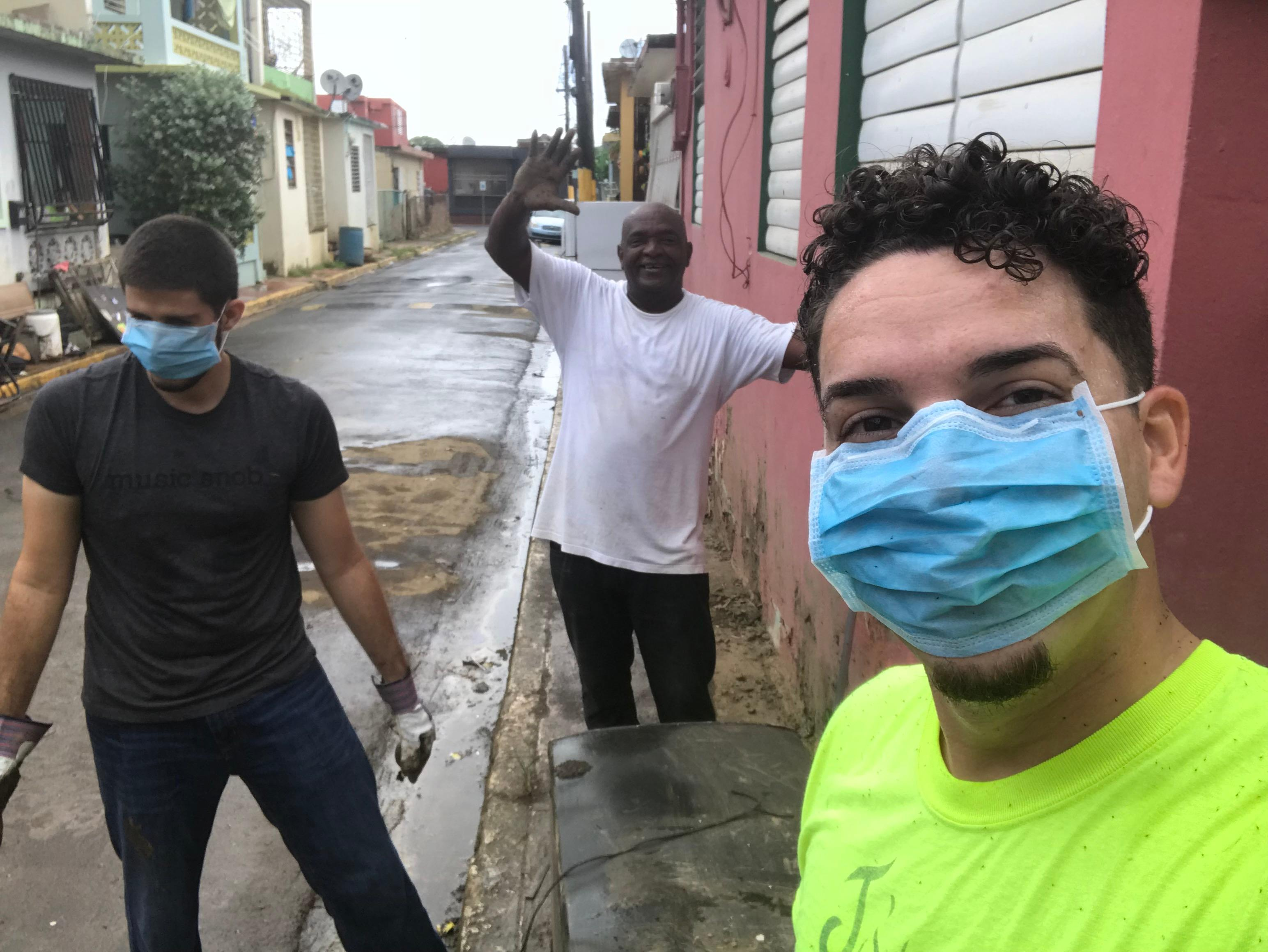 A selfie while cleaning houses in Toa Baja. Left to right: Matos-Moreno's best friend Alfonso, community member and volunteer Ruben, and Matos-Moreno. Alfonso cancelled a Thanksgiving trip to Miami to lend a hand.