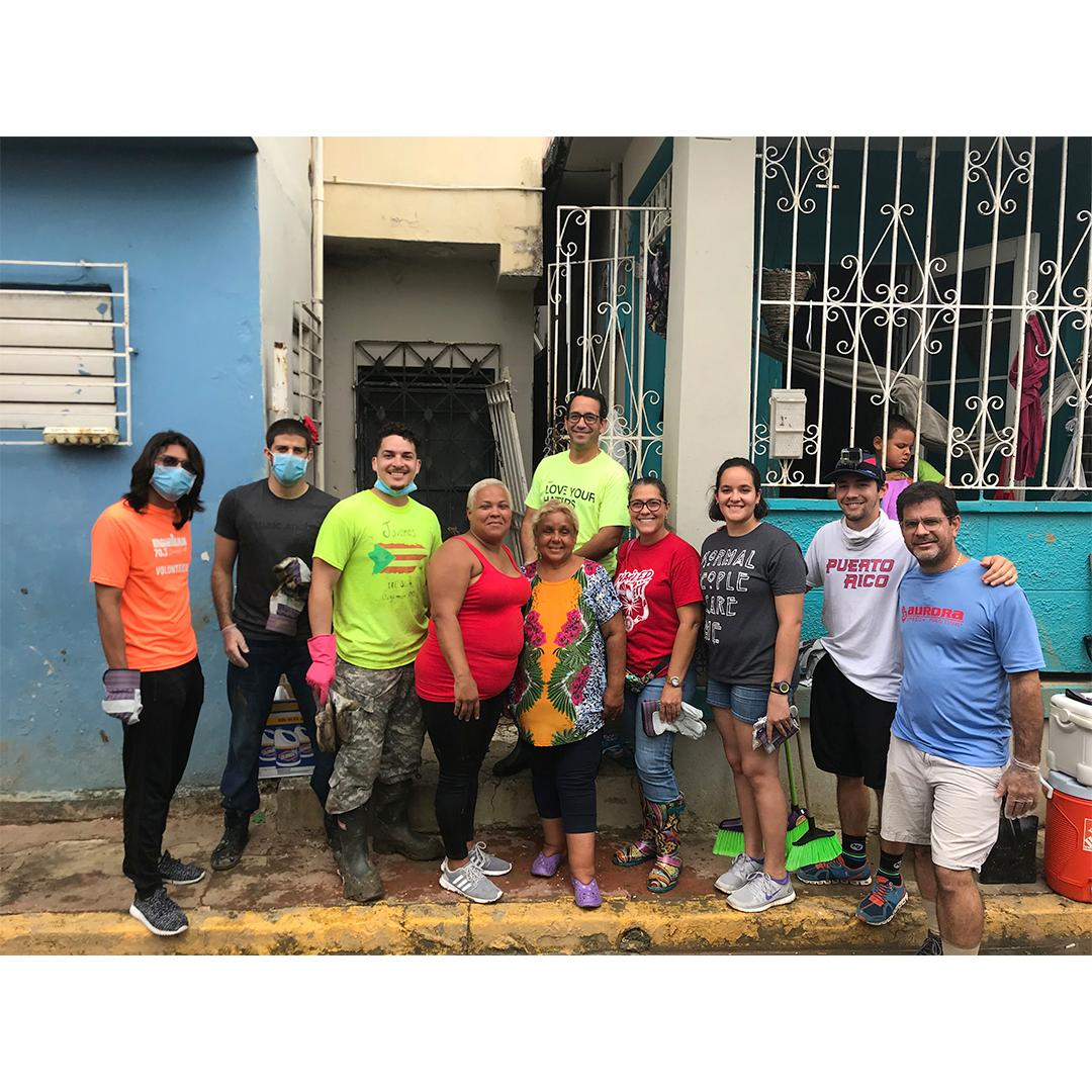 Amilcar Matos-Moreno with Maria and some of the volunteers that helped clean houses.
