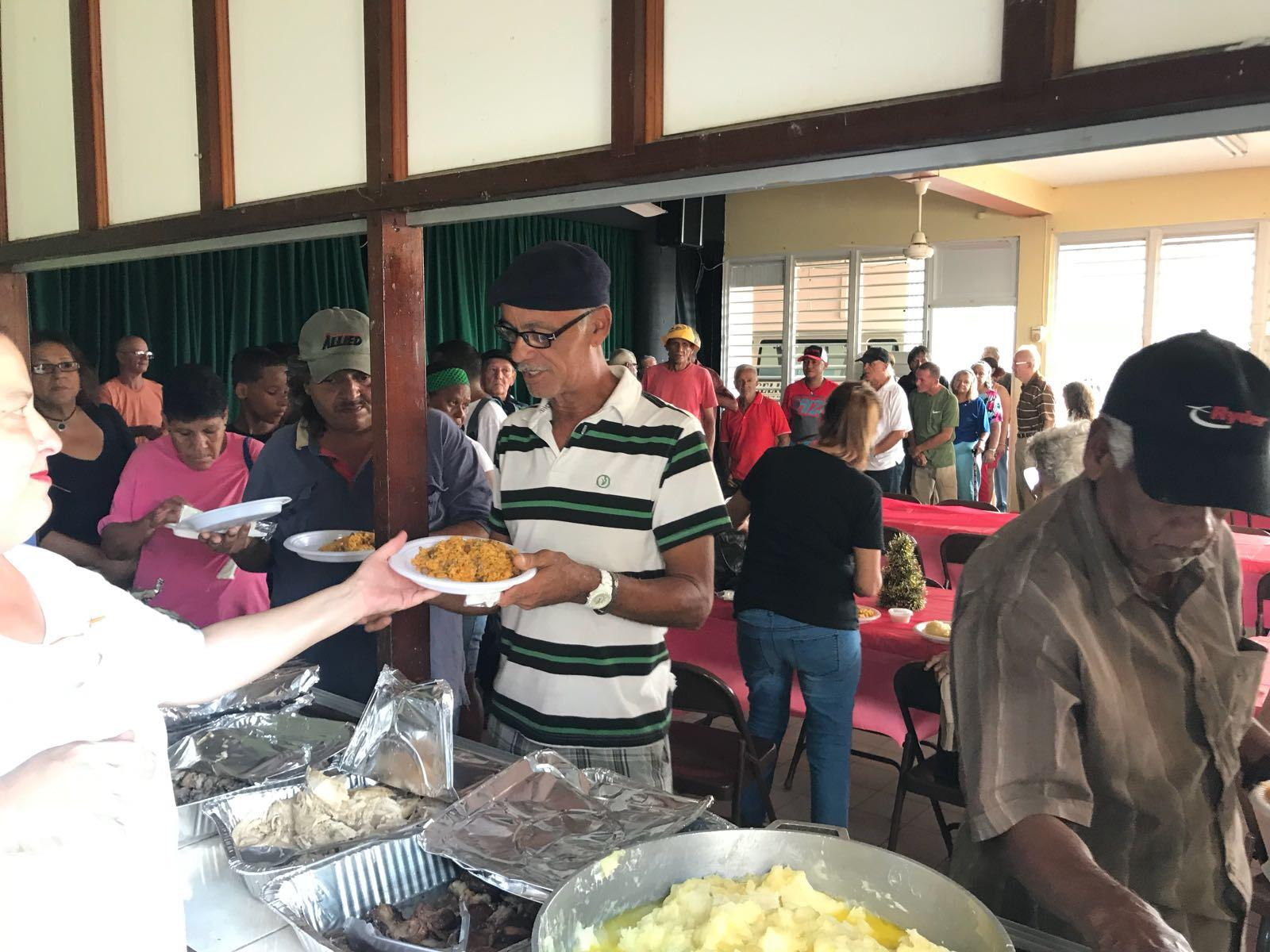Attendees being served food at the Christmas party.