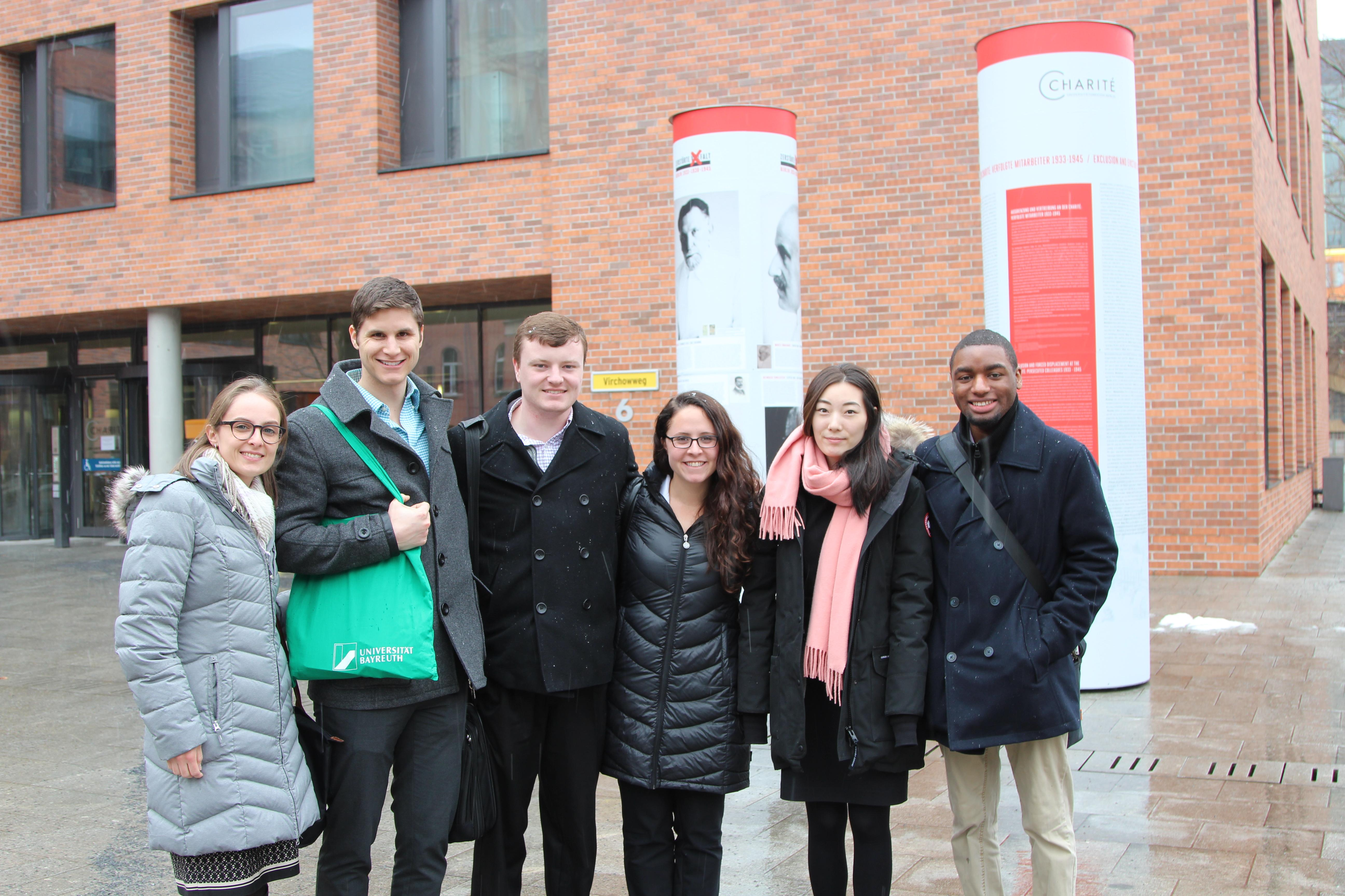 Left to right: Andrea Arathoon, John Crist, Peter Geppert, Jasmine Oesch, Constance Yang, and Quian Callender outside Charite, the largest Academic Medical Center in Berlin