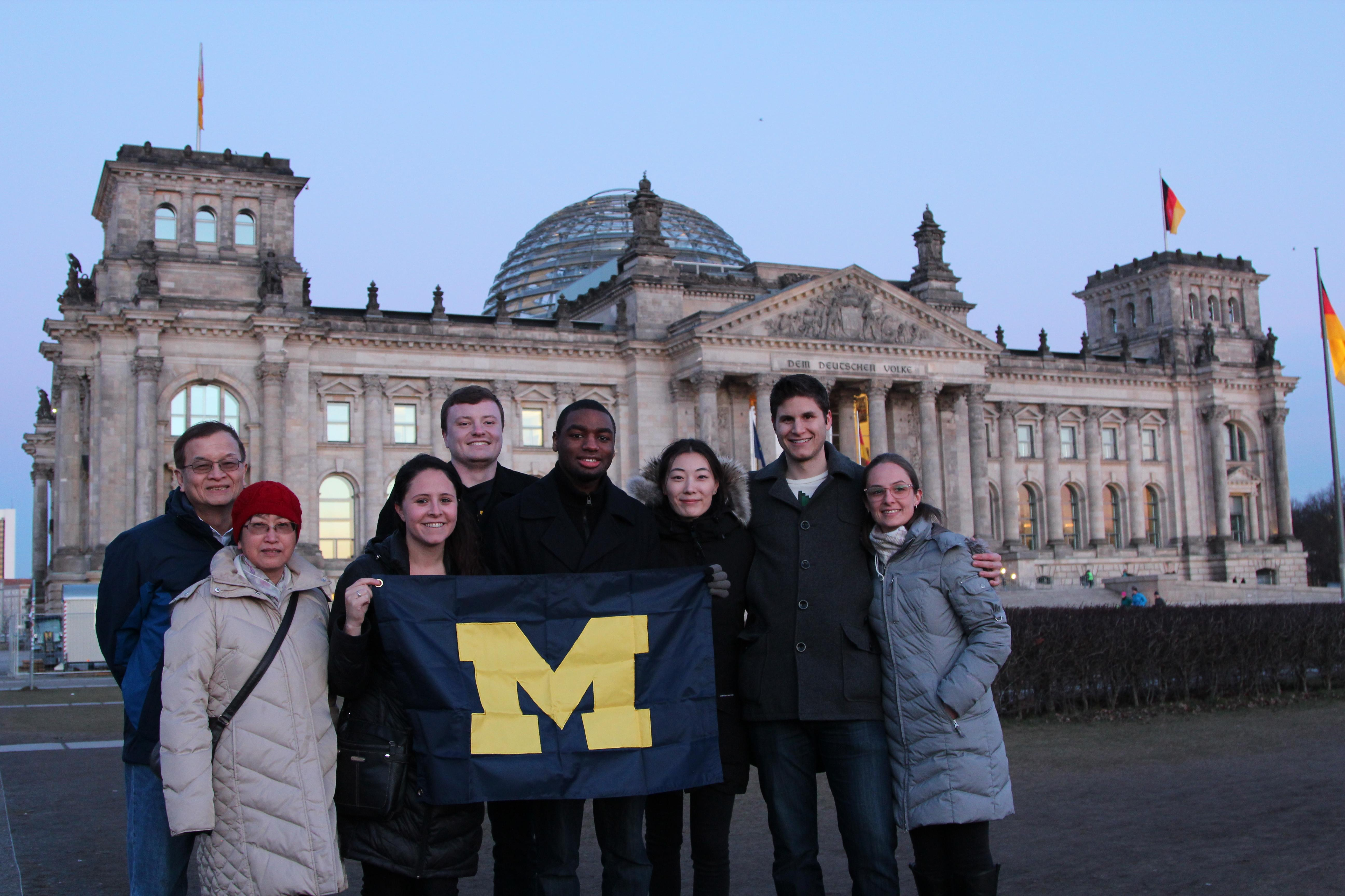 Left to right: Jersey Liang, Ling Hung, Jasmine Oesch, Peter Geppert, Quian Callender, Constance Yang, John Crist, and Andrea Arathoon outside the Reichstag building in Berlin