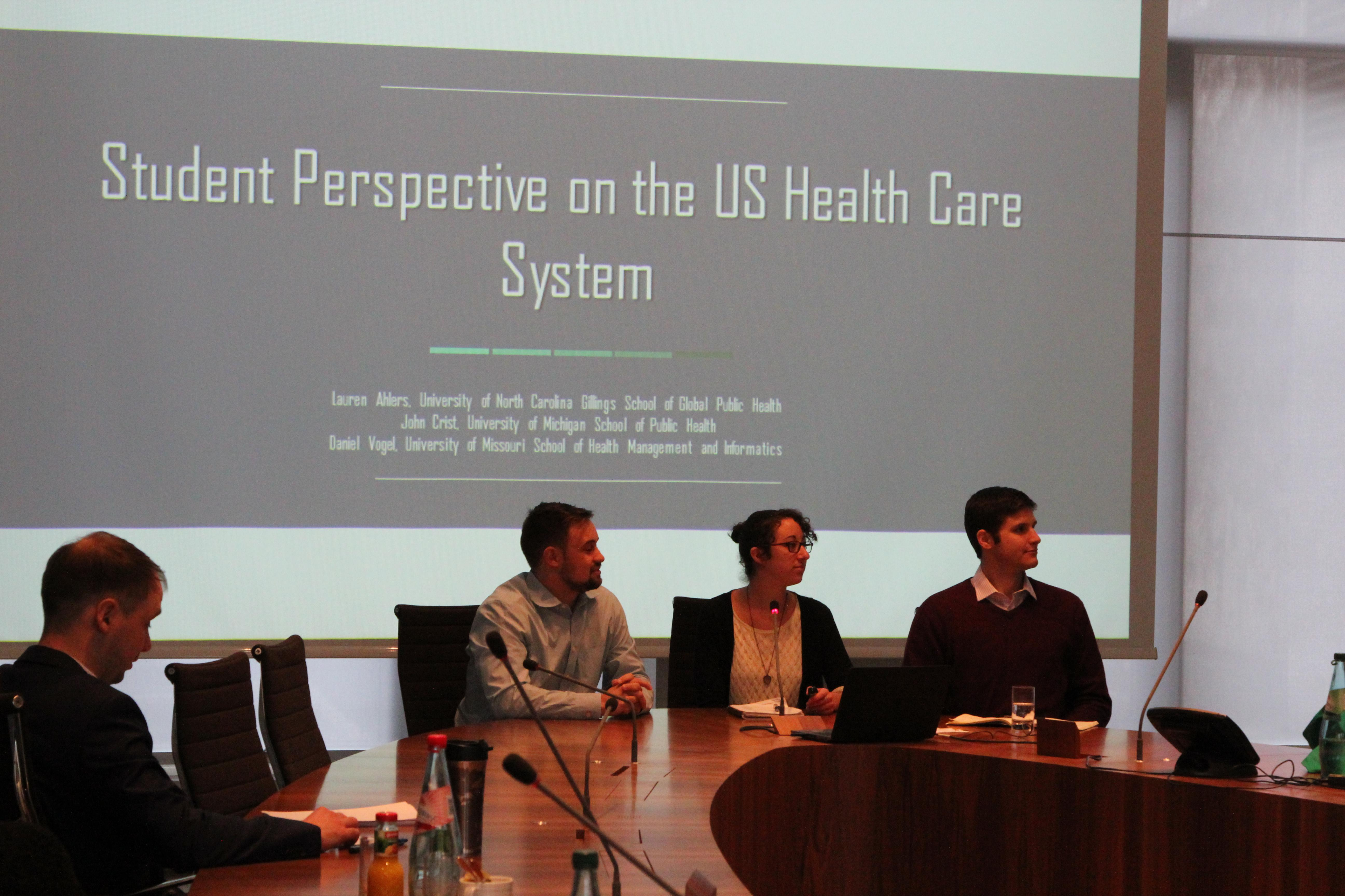 John Crist (right) presenting, along with students from the University of North Carolina and the University of Missouri, on the US health system for the director of Inpatient Reimbursement for Germany's largest Social Health Insurance Fund
