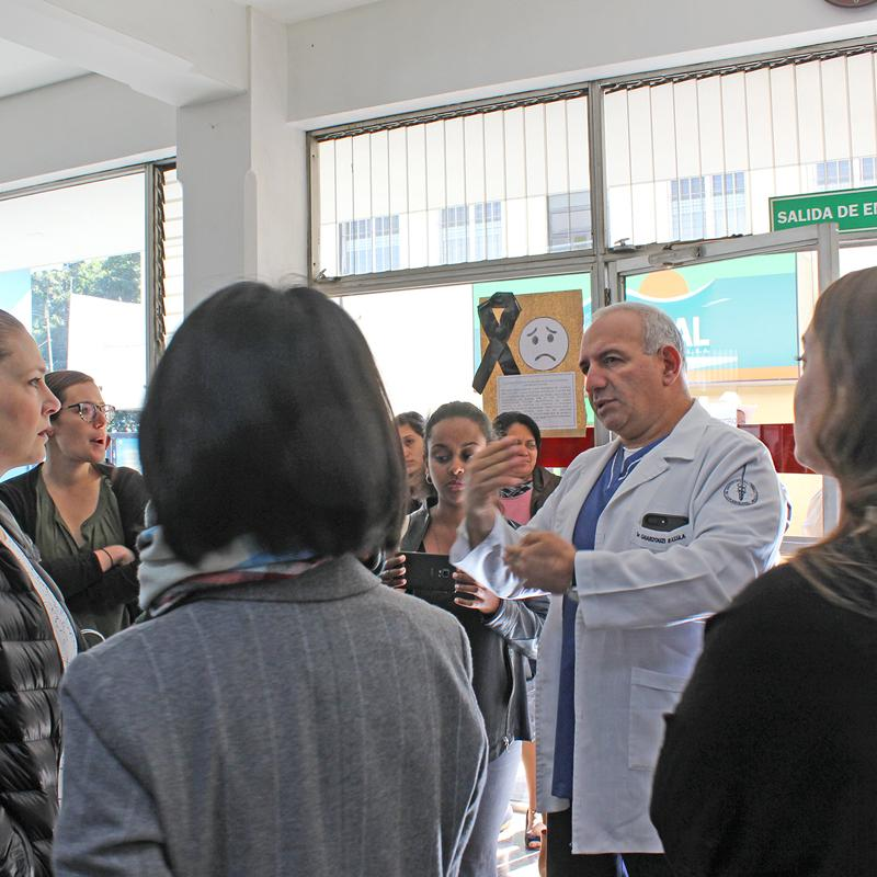Eduardo Gharzouzi, surgical oncologist and research director of Guatemala's Cancer Institute, gives a tour of the facility.
