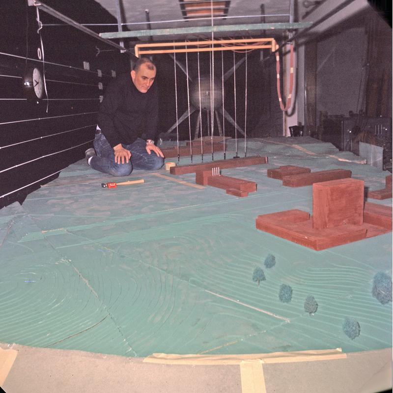Martin constructs a model of North Campus, measuring the accuracy of wind-tunnel readings against those on North Campus itself to ensure safety around the Phoenix Memorial Reactor.
