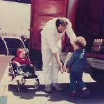 My older sister and I during our earliest working days helping our father load materials into his van (c. 1987).