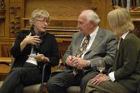 Photo of Dr. Noreen Clark speaking with guests in front of organ