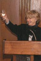 Photo of Dr. Clark proposing a toast