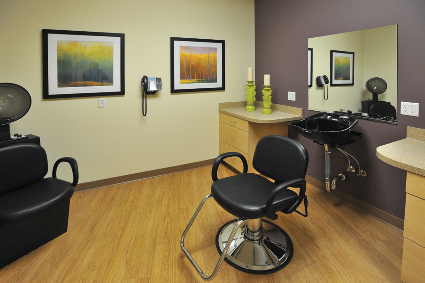 The assisted-living facility at Rivertown also includes a pharmacy, social room, two bathing suites, and a beauty salon/barber shop, where one resident gets his hair cut every week before church.