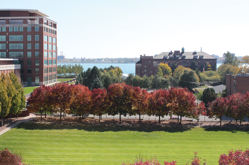 The UAW-GM Center for Human Resources leases an enclosed green space to Rivertown so that residents can have an inviting place to walk. Future plans include walking paths, benches, and a sculpture garden.