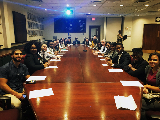 SEP 2016 Students in the Flint Hurley Medical Center Board Room listening to President/CEO Melany Gavulic, Chief Human Resource Officer Tyree Walker, and Flint Water Crisis Expert Dr. Mona.