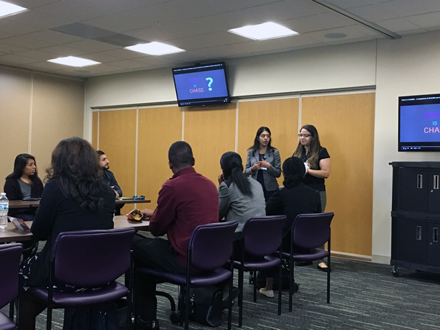 "SEP 2016 Students, Doris Valle-Rayo (standing, left) and Luisa Ferrerras (standing, right) present ""What is CHASS"" to their student cohort.  Both were placed at the Community Health and Social Services (CHASS) Center."