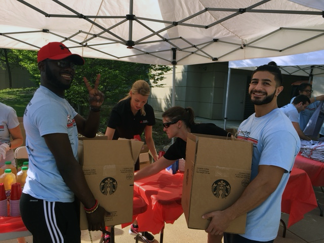 SEP 2016 students Joseph Gyasi (left) and Omar Abazeed (right) became the hit of the morning with riders and participants at the American Diabetes Association Tour de Cure race at Washtenaw Community College.  They were caught here volunteering as Starbucks coffee smilesmen!