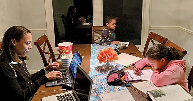 Tori Melendez, master's student in Health Management and Policy, enjoying family study time at home.