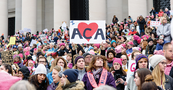A crowd gathers on the steps of the Lincoln Memorial to support the Affordable Care Act