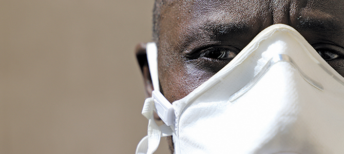 Closeup of an individual of African descent wearing a mask