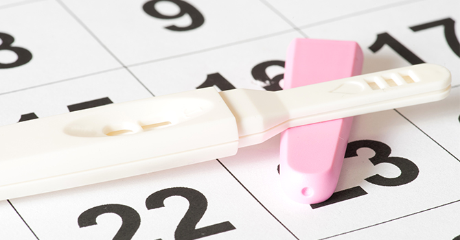 pregnancy test on top of calendar