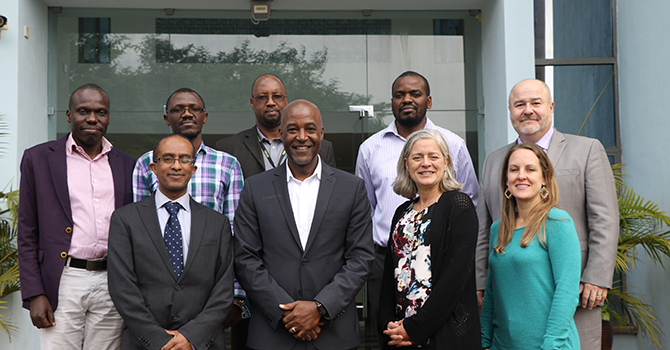Berhanu Gebremeskal, Amy Sarigiannis, DuBois Bowman, Rivet Amico, and Gary Harper of Michigan Public Health pose with members from the African Population Health Research Center (APHRC).