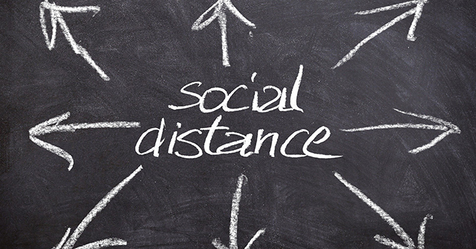 "chalkboard arrows and the words ""social distance"""