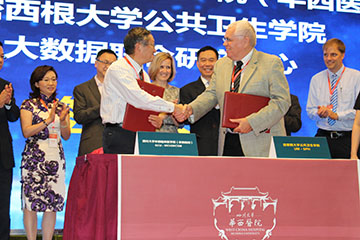 Leaders from the School of Public Health and West China Hospital sign the Joint Center agreement.
