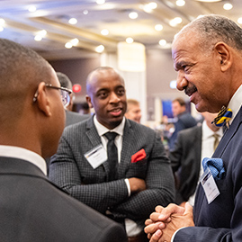 Griffith Leadership Center Advisory Board member Chris Allen connects with Michigan Public Health alumnus Vaughn Williams and current Health Management and Policy student John Rhodes.