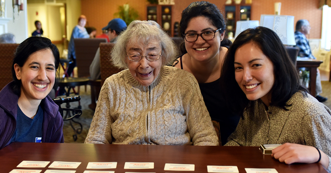 Michigan Public Health students with resident of a care facility