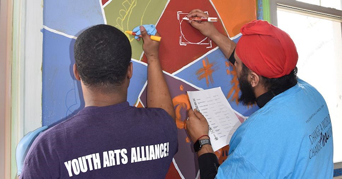 Jasdeep Kler volunteers with the Youth Arts Alliance