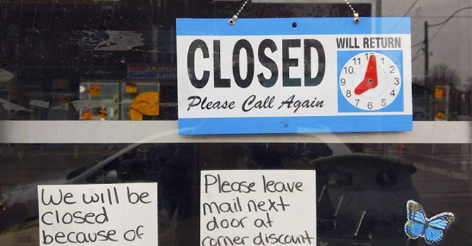 Closed sign on a storefront