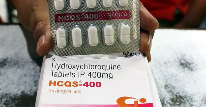 A pharmacist in India displays hydroxychloroquine tablets