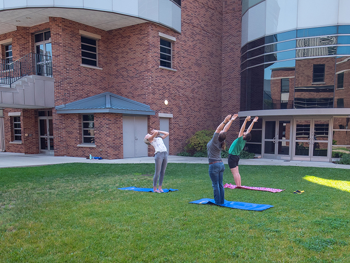 Kate teaching yoga in the courtyard