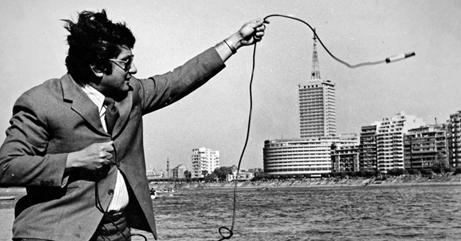Khalil Hosny Mancy, professor emeritus of Environmental Health Sciences, lowers an oxygen sensor into the Nile River as it runs through Cairo in 1971.