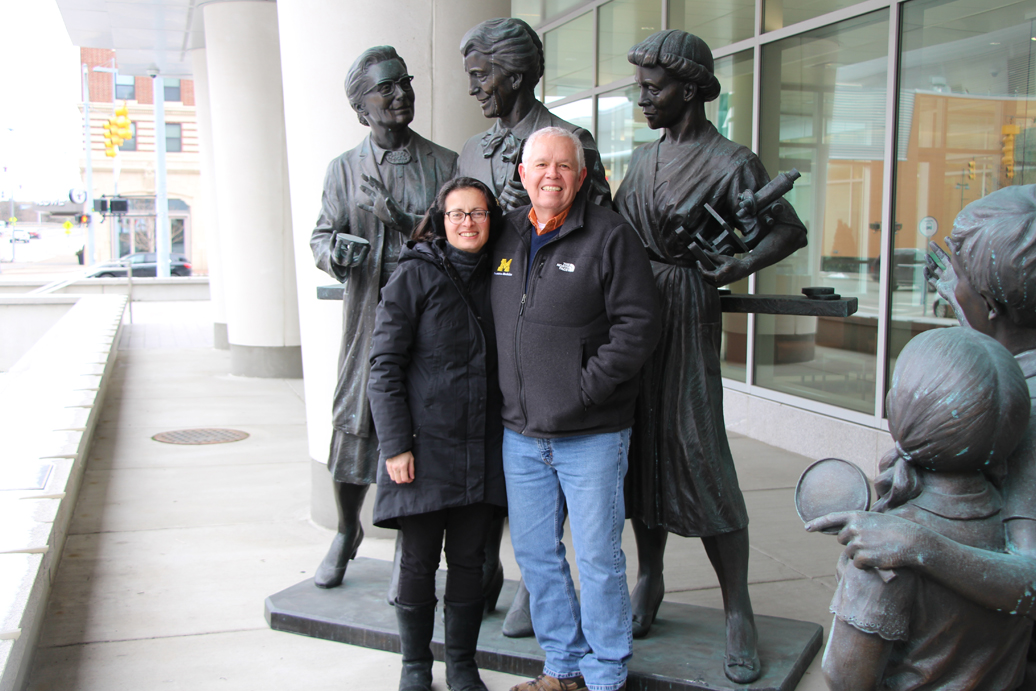 Matt Boulton and his wife, Chitra, with the statue of Kendrick, Eldering, and Gordon unveiled in September 2019 in Grand Rapids.