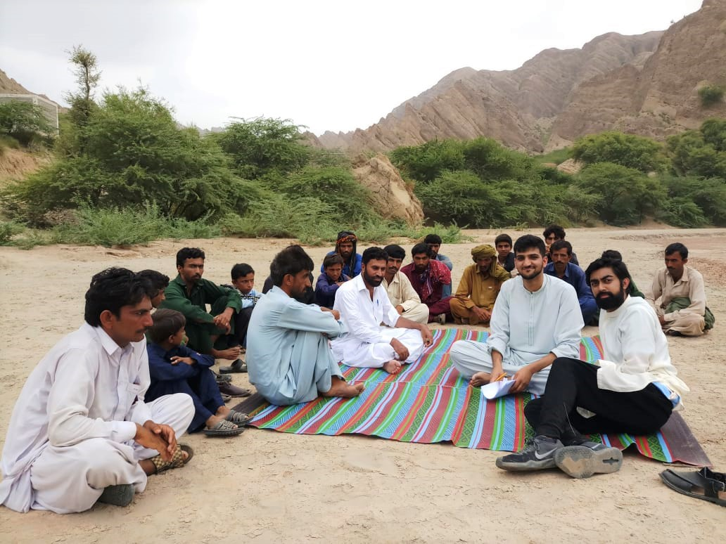 Omar Ilyas (foreground on the right) worked for the American Pakistan Foundation as a research analyst and traveled throughout Pakistan to meet with residents to discuss water contamination and health