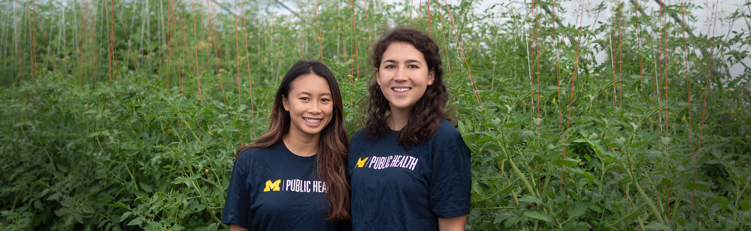 undergraduate students at campus farm