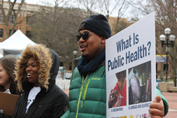 students on campus promoting public health